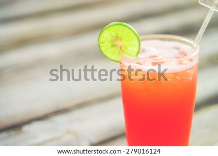 Ice Punch cocktails with lemon lime - vintage filter - stock photo