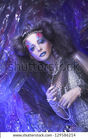 Ice queen. Young woman in artistic image.