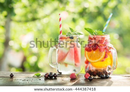 Ice refreshing summer drink on blurred background. - stock photo