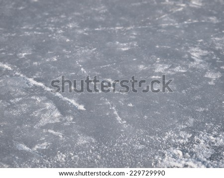 Ice rink surface background with selective focus,  hockey and figure skates tracks and scratches texture - stock photo
