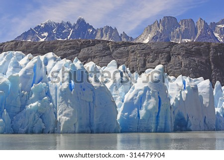 Ice, Rocks, and Mountains by the Grey Glacier in Torres del Paine National park in Patagonian, Chile - stock photo