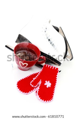 ice skate with cup of hot tea and gloves on white