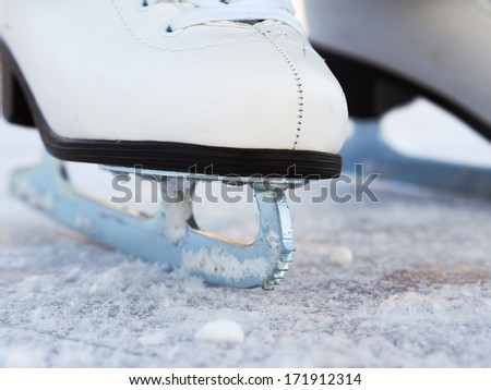 Ice skates on a lake in winter