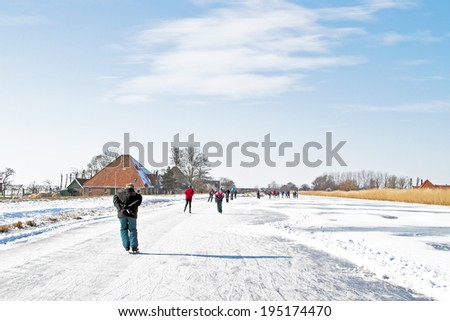Ice skating in the countyside from the Netherlands - stock photo