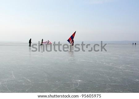 Ice skating on Neusiedler See in eastern Austria. - stock photo