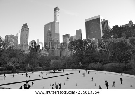 Ice-skating people with white Christmas in Central Park on November 10, 2014 in Manhattan, New York City, USA. - stock photo