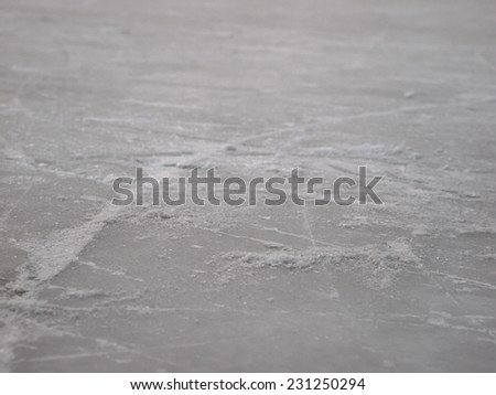 Ice skating rink surface background with selective focus,  hockey and figure skate sport wallpaper with copy space - stock photo