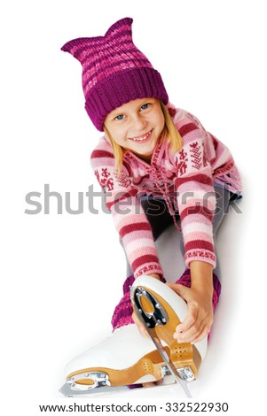 Ice skating. The little girl sitting on ice in ice skating. Isolated on white background. - stock photo
