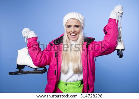 ice skating winter woman holding ice skates