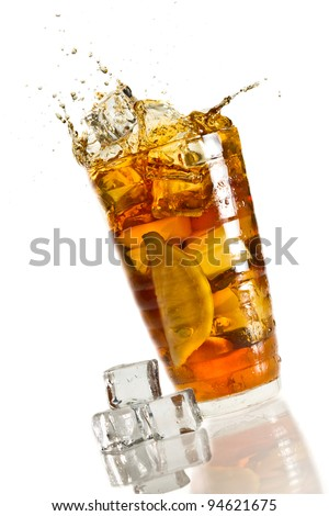 Ice splash in a glass with lemon tea - stock photo