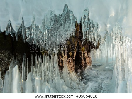 Ice stalactites and stalagmites in the rock. - stock photo
