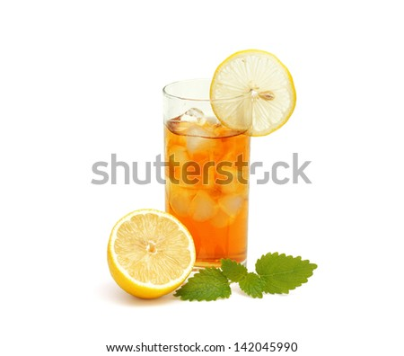 Ice  tea in glass  with lemon and melissa isolated on  white - stock photo