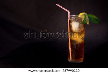Ice tea isolated on black background