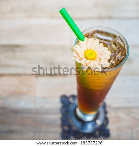 Ice tea on wood background - stock photo