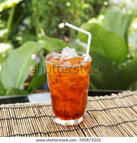 Ice Tea Thai style on the garden background - stock photo
