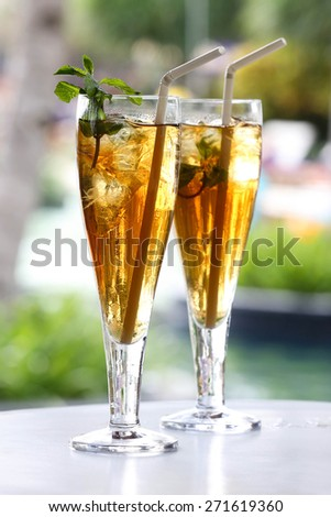 Ice tea Two glasses of iced tea with mint garnish - stock photo