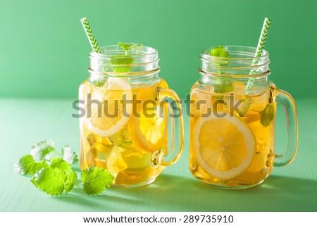 ice tea with lemon and melissa in mason jars - stock photo