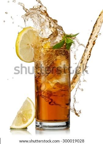 Ice tea with lemon splash - stock photo