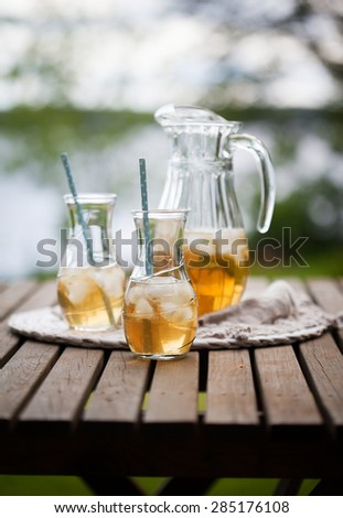 Ice tea with mint leaves - stock photo