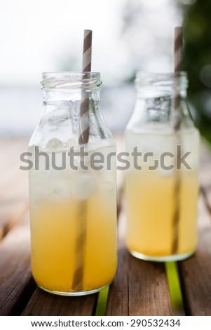 Ice tea with paper straws - stock photo