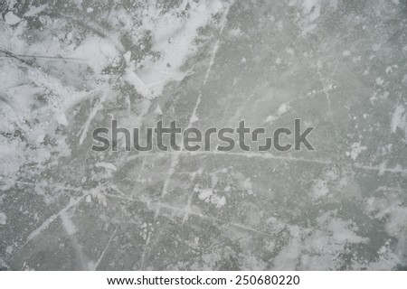 Ice texture on outdoor rink, on Lafontaine park lake, in Montreal, Canada - stock photo