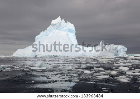 Iceberg at the Ross sea with reflection. - stock photo