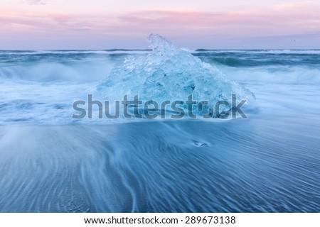 Iceberg beach at Vatnajokull Glacier Jokulsarlon Iceland sunrise - stock photo