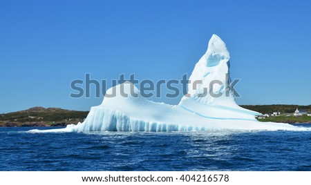 Iceberg, Cape Bonavista is a headland located on the east coast of the island of Newfoundland in the Canadian province of Newfoundland and Labrador. - stock photo