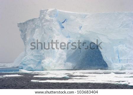 Iceberg in blizzard. - stock photo