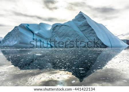Iceberg in Greenland. Icebergs are majestic natural works of art heading out to sea. These sculptures that are up to 100 metres high are a formidable sight. - stock photo