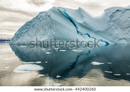 Iceberg in Greenland. No two icebergs are alike, and when you see an iceberg for the first time, you may be seeing shapes and sizes that no-one has seen before.  - stock photo