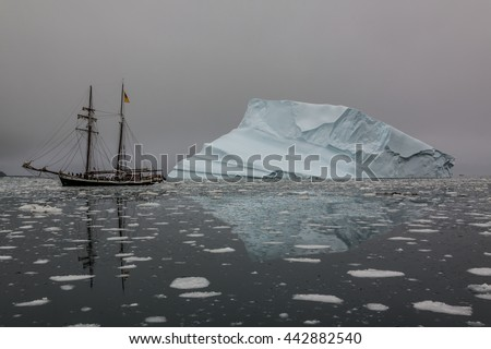 Iceberg in Greenland. Some parts of Greenland are only accessible by sea. - stock photo