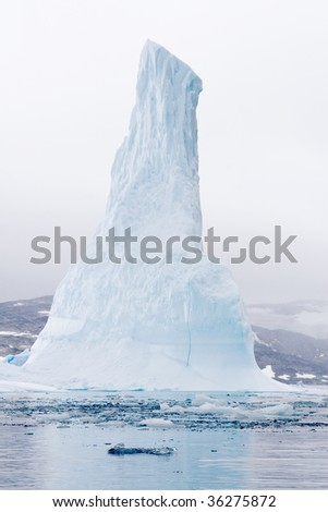 Iceberg in the early morning mist in Nappasorsuaq Fjord, Greenland - stock photo