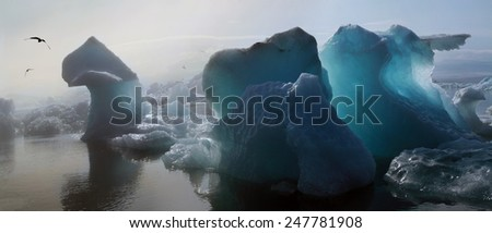 Iceberg in the glacier lagoon - stock photo