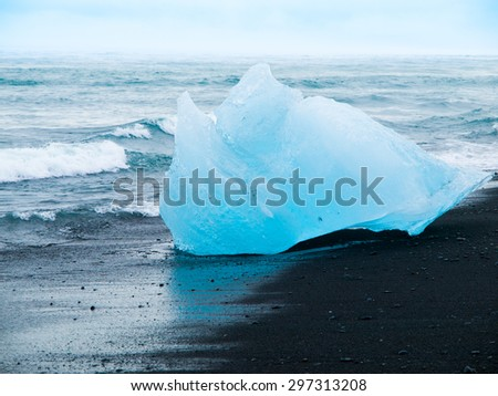 Iceberg on black beach near Jokulsarlon glacier lake