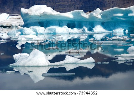 Iceberg reflections on the lake Jokulsarlon