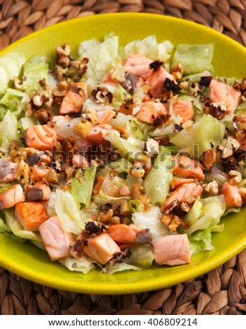 Iceberg salad with baked salmon flakes and crushed walnuts/pecans