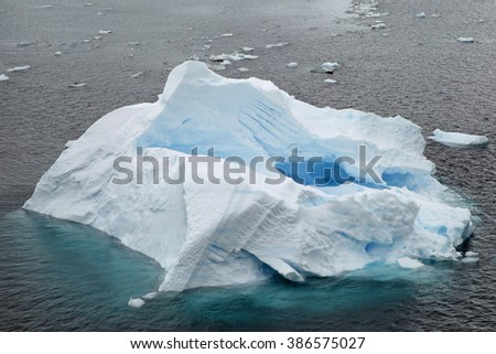 Iceberg sculpted by wind and water in Paradise Bay, Antarctica