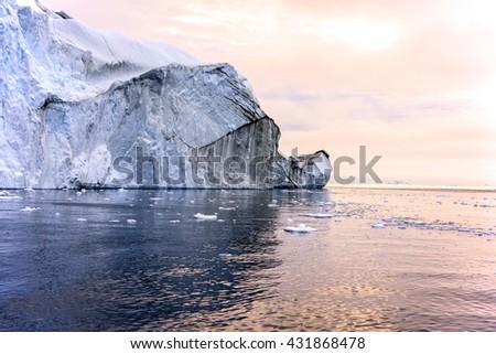 Iceberg with sunset on arctic ocean in Ilulissat, Greenland - stock photo