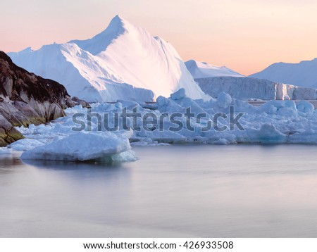 Icebergs and glaciers at the north pole of the world, in Ilulissat, Greenland.
