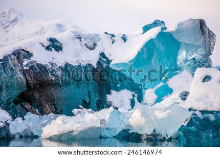 icebergs at crystal black beach in south Iceland - stock photo