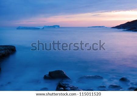 Icebergs at sunrise. - stock photo