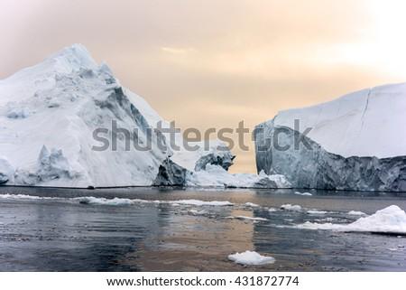 Icebergs broken on arctic ocean, Greenland - stock photo