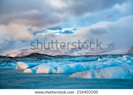 Icebergs drifting to sea in Jokulsarlon - Iceland - stock photo