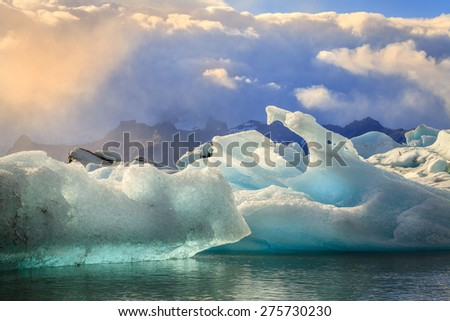 Icebergs floating in Jokulsarlon Lagoon by the southern coast of Iceland - stock photo