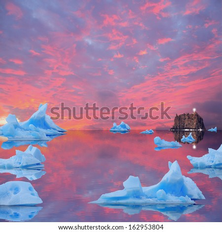 Icebergs floating in the sea at sunset.  - stock photo