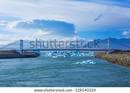 Icebergs in the strait to the bridge glacier lake Jokulsarlon, glacier Vatnajokull, Iceland. - stock photo