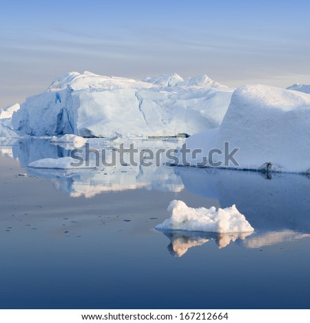 Icebergs of polar regions. Floating parts of continental ices. - stock photo