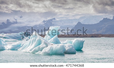 Icebergs swimming on world famous Jokulsarlon glacier lagoon in southern Iceland