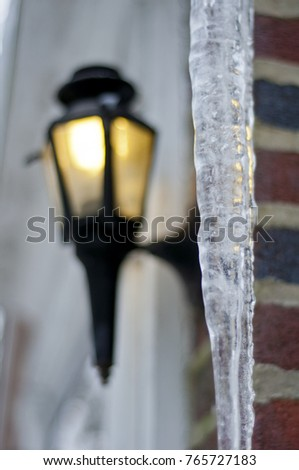 Icecle and a street light outside a building at Christmas time